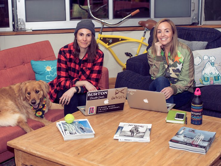 Caitlin Bergin (Women's Brand Manager), her assistant Maple, and Whitney Heingartner (Partnerships Manager) pow-wow on the Marketing couches.