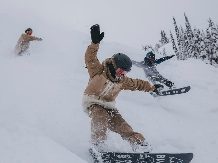 A group of riders in powder