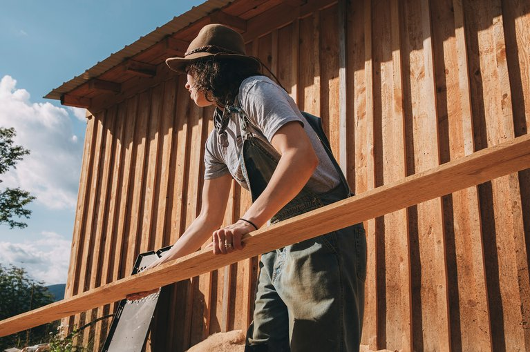 A Burton Employee Living off the Grid in Vermont | Taylor outside their sawmill.