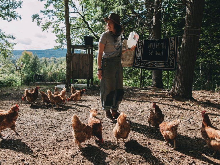 Taylor Mayo feeding her chickens