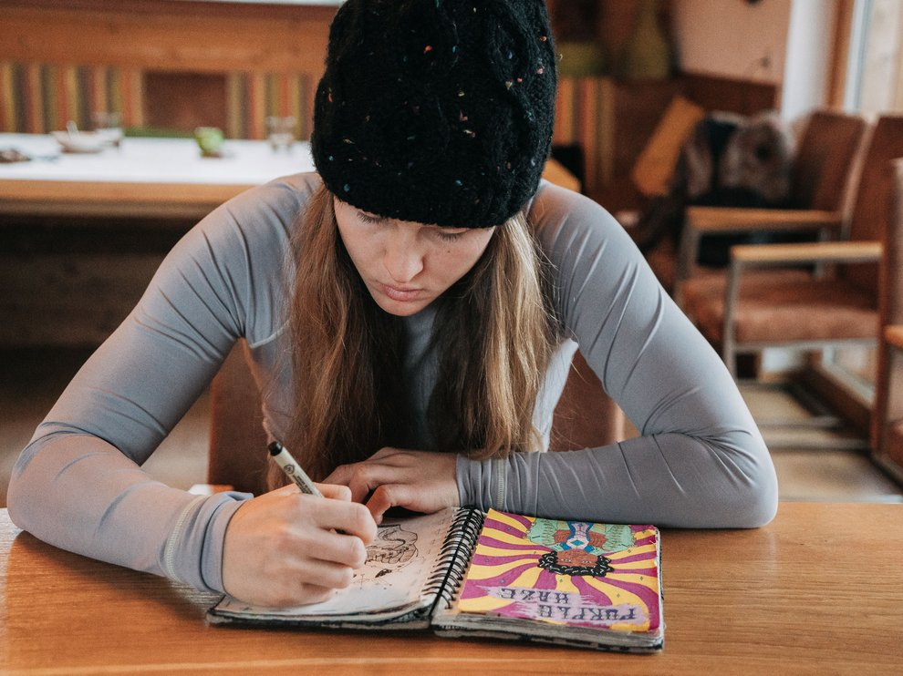 Julia Marino drawing in her notebook in Austria_Blotto_5227.jpg
