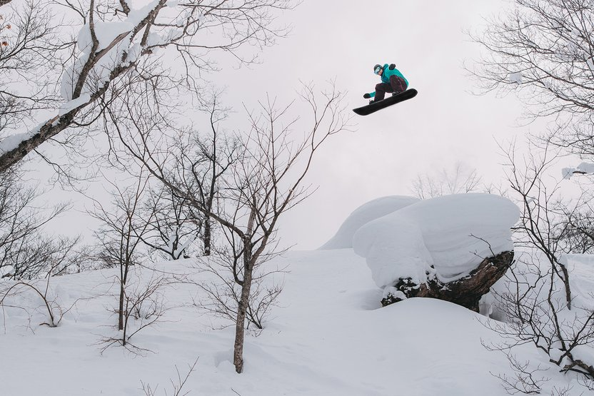 Kimmy Fasani, frontside 540 off the pillow and over the trees.