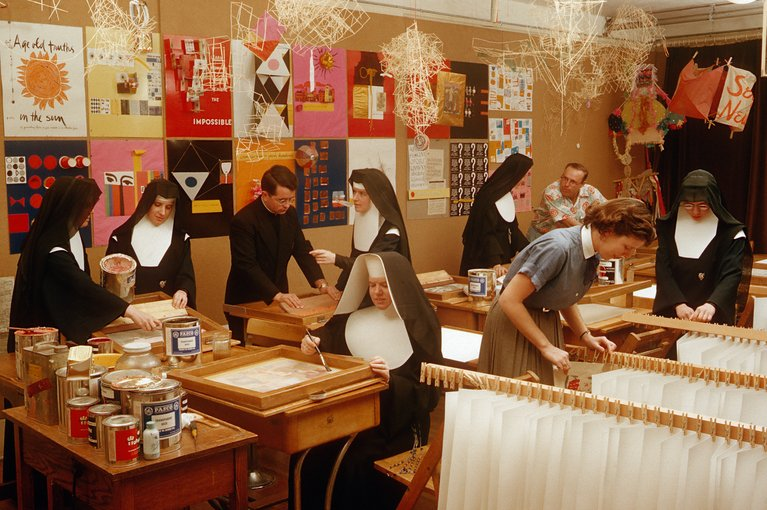 A group of nuns making prints