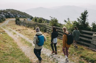 A group walking on a dirt path in Vermont