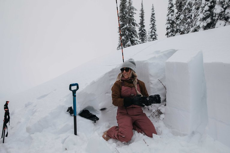 Why You Should Take an Avalanche Safety Course - Digging a Snow Pit